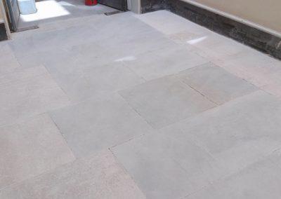 grinding sandstone