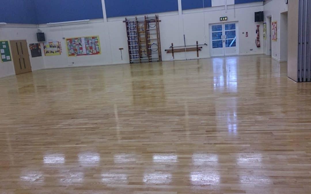 Sanding and polishing Gym Hall floor